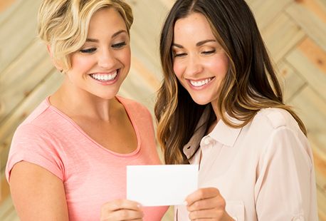 women looking at a card